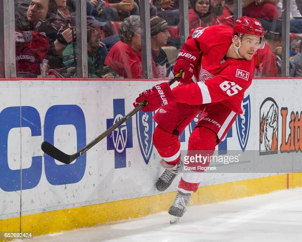 Danny DeKeyser of the Detroit Red Wings shoots the puck along the boards during an NHL game against the Chicago Blackhawks at Joe Louis Arena on...