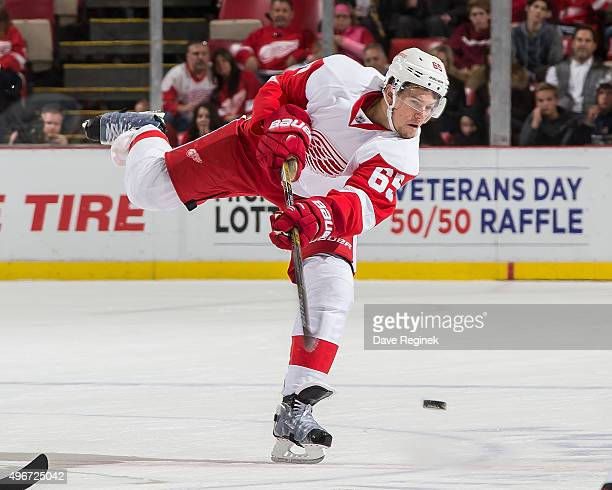 Danny DeKeyser of the Detroit Red Wings shoots the puck during an NHL game against the Ottawa Senators at Joe Louis Arena on October 30 2015 in...