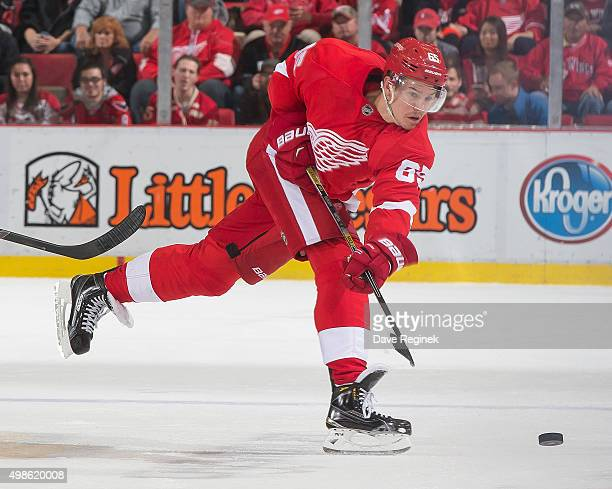 Danny DeKeyser of the Detroit Red Wings shoots the puck during an NHL game against the Washington Capitals at Joe Louis Arena on November 18 2015 in...
