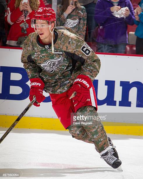 Danny DeKeyser of the Detroit Red Wings skates in warmups with his camo jersey in honor of Military Appreciation Night prior to the NHL game against...