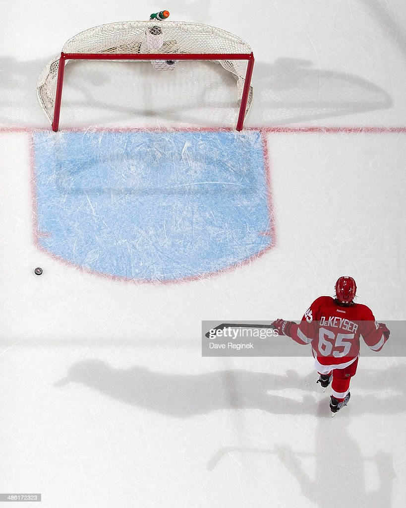 Danny DeKeyser #65 of the Detroit Red Wings skates past the puck after Patrice Bergeron #37 of the Boston Bruins (not pictured) shoots it into the empty net during Game Three of the First Round of the 2014 Stanley Cup Playoffs on April 22, 2014 at Joe Louis Arena in Detroit, Michigan. Bruins defeated Detroit 3-0
