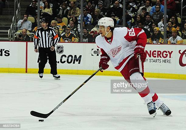 Danny DeKeyser of the Detroit Red Wings skates with the puck during a game against the Pittsburgh Penguins at Consol Energy Center on February 11...
