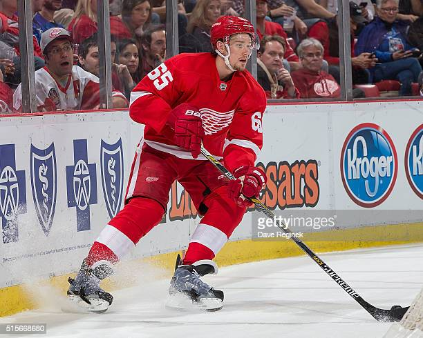 Danny DeKeyser of the Detroit Red Wings stops behind the net with the puck during an NHL game against the New York Rangers at Joe Louis Arena on...