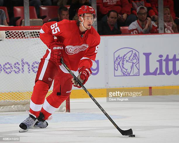Danny DeKeyser of the Detroit Red Wings turns up ice with the puck against the Pittsburgh Penguins during a NHL game on October 23 2014 at Joe Louis...