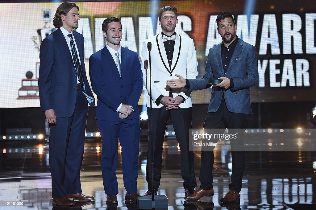 Danny Dekeyser of the Detroit Red Wings, Tyler Johson of the Tampa Bay Lightning, Semyon Varlamov of the Colorado Avalanche and Canadian television and radio personality George Stroumboulopoulos present the Jack Adams Award during the 2014 NHL Awards at the Encore Theater at Wynn Las Vegas on June 24, 2014 in Las Vegas, Nevada.