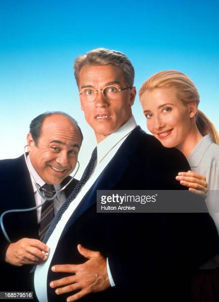 Danny DeVito Arnold Schwarzenegger and Emma Thompson in movie art for the film 'Junior' 1994