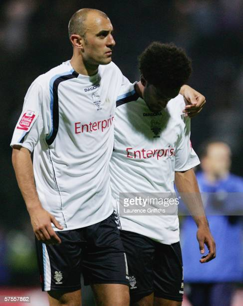 Danny Dichio of Preston consoles Youl Mawene after the Cocacola PlayOff Semi Final Second Leg match between Preston North End and Leeds United at...