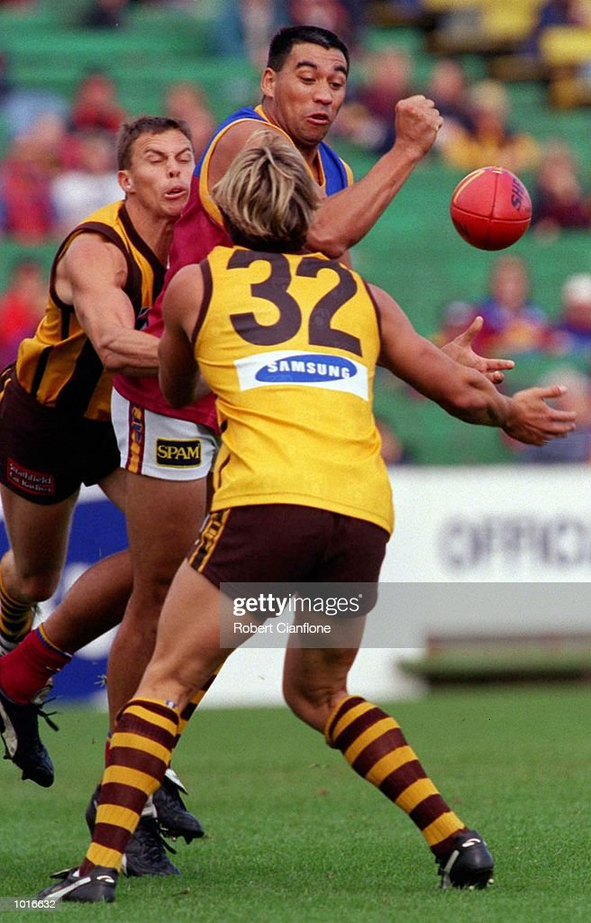 Danny Dickfos of Brisbane punches the ball clear of Ben Dixon of Hawthorn, in the match between Hawthorn and the Brisbane Lions, during round five of the AFL season, played at Waverley Park, Melbourne, Australia. Mandatory Credit: Robert Cianflone/ALLSPORT