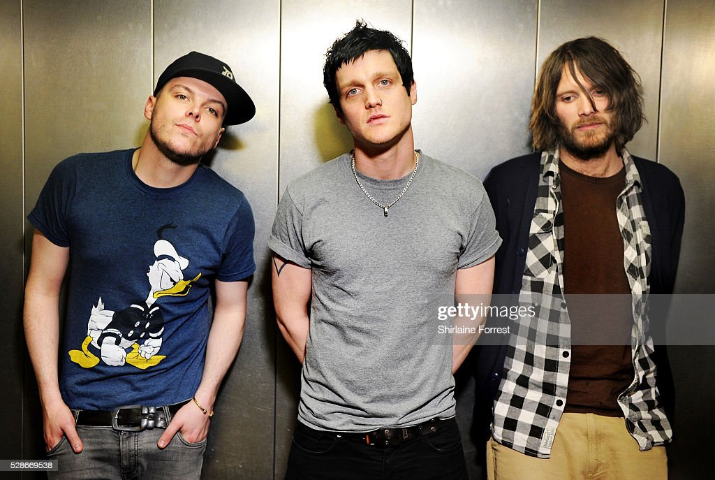Danny Dolan, Ally Dickaty and Matt Rose of The Virginmarys pose backstage after performing live and signing copies of their new album 'Divides' at Fopp on May 6, 2016 in Manchester, England.