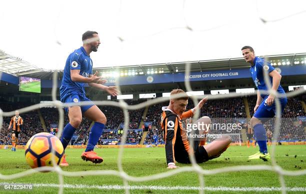Danny Drinkwater of Leicester City and Robert Huth of Leicester City react to Sam Clucas of Hull City scoring his sides first goal during the Premier...