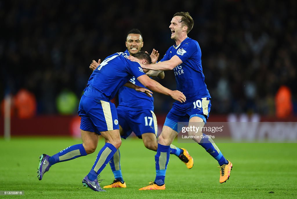 Danny Drinkwater (L) of Leicester City celebrates scoring his team's first goal with his team mates Andy King (R) and Danny Simpson (C) during the Barclays Premier League match between Leicester City and West Bromwich Albion at The King Power Stadium on March 1, 2016 in Leicester, England.