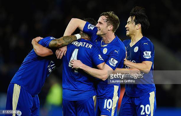 Danny Drinkwater of Leicester City celebrates scoring his team's first goal with his team mates Andy King Danny Simpson and Shinji Okazaki during the...