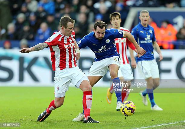 Danny Drinkwater of Leicester City competes with Glen Whelan of Stoke City during the Premier League match between Leicester City and Stoke City at...