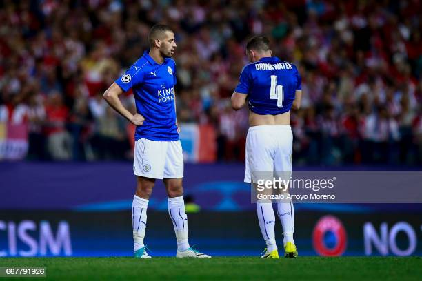 Danny Drinkwater of Leicester City FC and his teammate Islam Slimani reacts during the UEFA Champions League Quarter Final first leg match between...