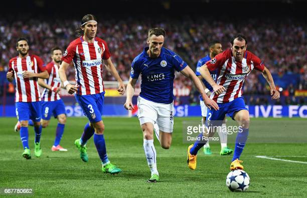 Danny Drinkwater of Leicester City holds off pressure from Diego Godin of Atletico Madrid during the UEFA Champions League Quarter Final first leg...