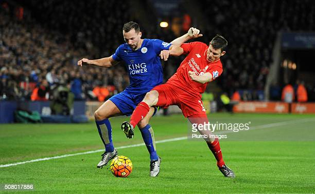 Danny Drinkwater of Leicester City in action with James Milner of Liverpool during the Barclays Premier League match between Leicester City and...