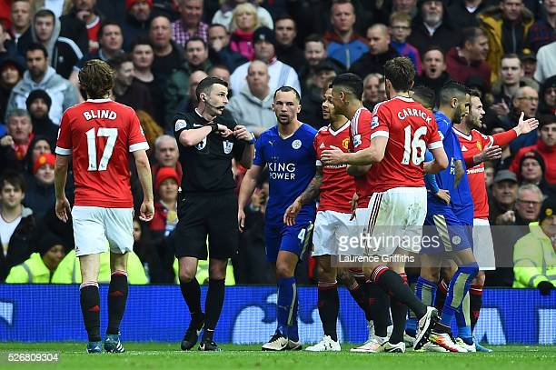 Danny Drinkwater of Leicester City is sent off by referee Michael Oliver during the Barclays Premier League match between Manchester United and...
