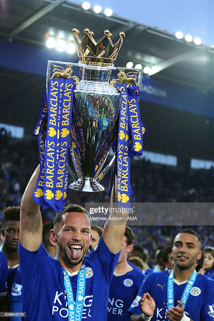 Danny Drinkwater of Leicester City lifts the Premier League Trophy as Leicester City celebrate becoming Premier League Champions for the 2015/16...