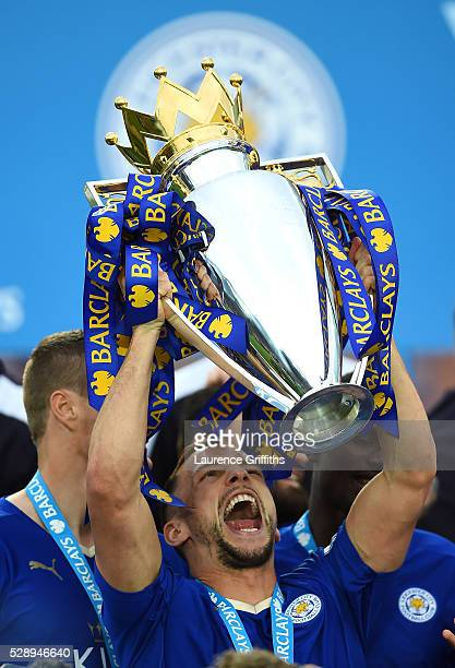 Danny Drinkwater of Leicester City lifts the Premier League Trophy as players and staffs celebrate the season champions after the Barclays Premier...