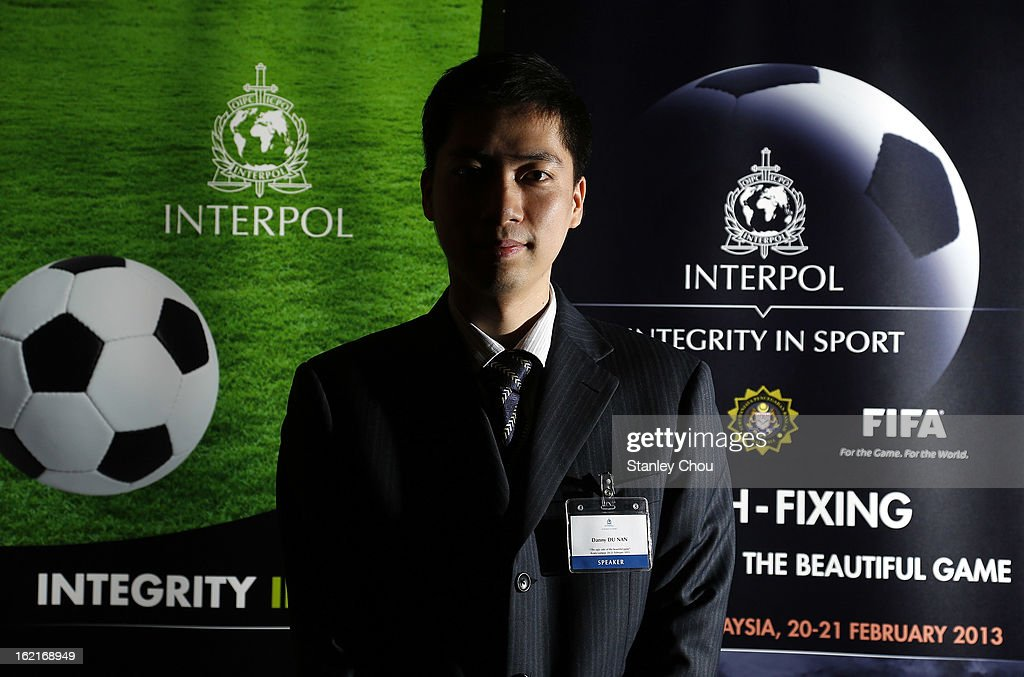 Danny Du Nan, Ministry of Public Security in China and speaker for match fixing investigation during an INTERPOL (International Criminal Police Organization) conference at a hotel on February 20, 2013 in Kuala Lumpur, Malaysia. Law enforcement officials and representatives from football associations gather in Malaysia to discuss 'Match fixing: The Ugly Side of the Beautiful Game'.