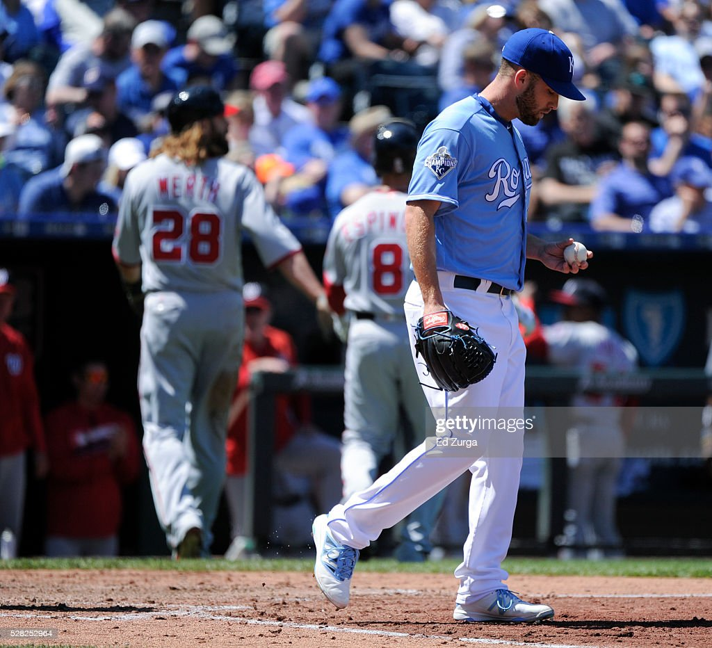 Danny Duffy #41 of the Kansas City Royals looks down at the ball after giving up a sacrifice fly to Danny Espinosa #8 of the Washington Nationals in the third inning at Kauffman Stadium on May 4, 2016 in Kansas City, Missouri.