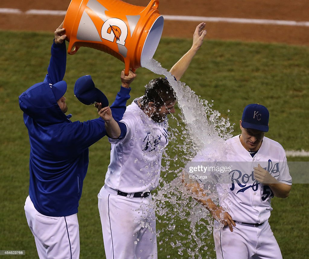 <a gi-track='captionPersonalityLinkClicked' href=/galleries/search?phrase=Danny+Duffy&family=editorial&specificpeople=5971971 ng-click='$event.stopPropagation()'>Danny Duffy</a> #41 of the Kansas City Royals pours water on <a gi-track='captionPersonalityLinkClicked' href=/galleries/search?phrase=Aaron+Crow&family=editorial&specificpeople=6780128 ng-click='$event.stopPropagation()'>Aaron Crow</a> #43 and <a gi-track='captionPersonalityLinkClicked' href=/galleries/search?phrase=Jason+Frasor&family=editorial&specificpeople=213654 ng-click='$event.stopPropagation()'>Jason Frasor</a> #54 after a 2-1 win over the Texas Rangers at Kauffman Stadium on September 2, 2014 in Kansas City, Missouri.
