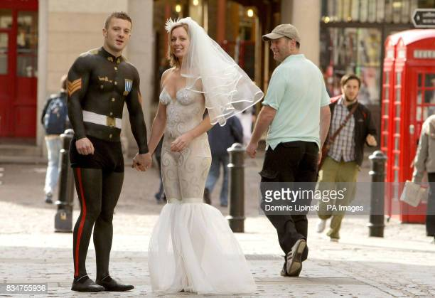 Danny Duggan and Caroline Clark from Sheffield attract attention from members of the public as they walk through Covent Garden London as part of a...