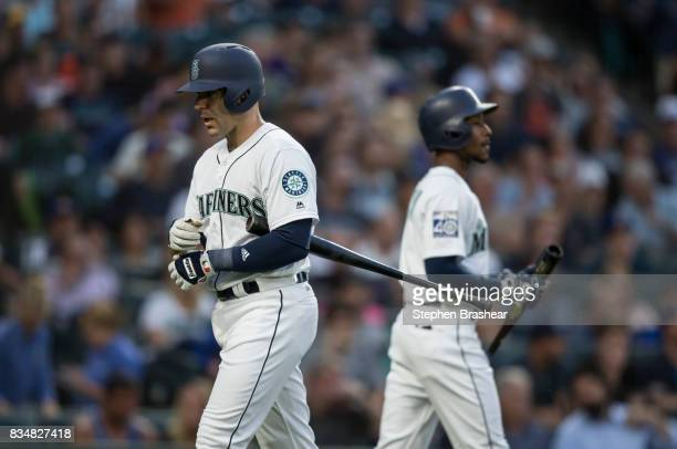 Danny Espinosa left of the Seattle Mariners walks past Jarrod Dyson of the Seattle Mariners after an atbat during a game against the Baltimore...