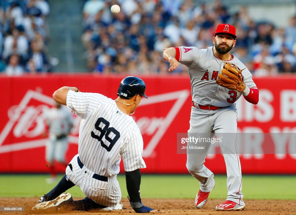 Danny Espinosa #3 of the Los Angeles Angels of Anaheim completes a third inning double play after forcing out Aaron Judge #99 of the New York Yankees at Yankee Stadium on June 21, 2017 in the Bronx borough of New York City.