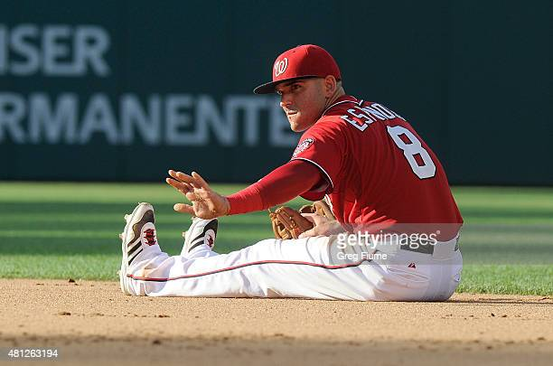 Danny Espinosa of the Washington Nationals asks for time after injuring his leg in the ninth inning against the Los Angeles Dodgers at Nationals Park...