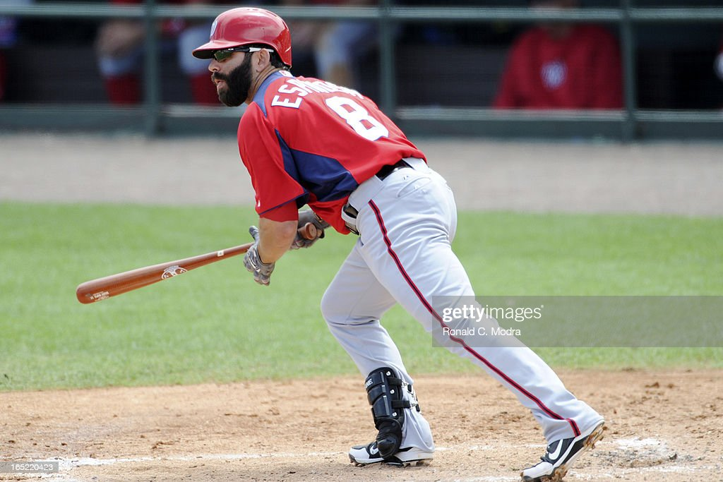 Danny Espinosa #8 of the Washington Nationals bats during a spring training game against the Miami Marlins at Roger Dean Stadium on March 26, 3012 in Jupiter, Florida.