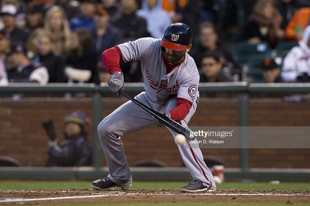 <a gi-track='captionPersonalityLinkClicked' href=/galleries/search?phrase=Danny+Espinosa&family=editorial&specificpeople=4410764 ng-click='$event.stopPropagation()'>Danny Espinosa</a> #8 of the Washington Nationals bunts against the San Francisco Giants during the fourth inning at AT&T Park on May 21, 2013 in San Francisco, California. The San Francisco Giants defeated the Washington Nationals 4-2 in 10 innings.