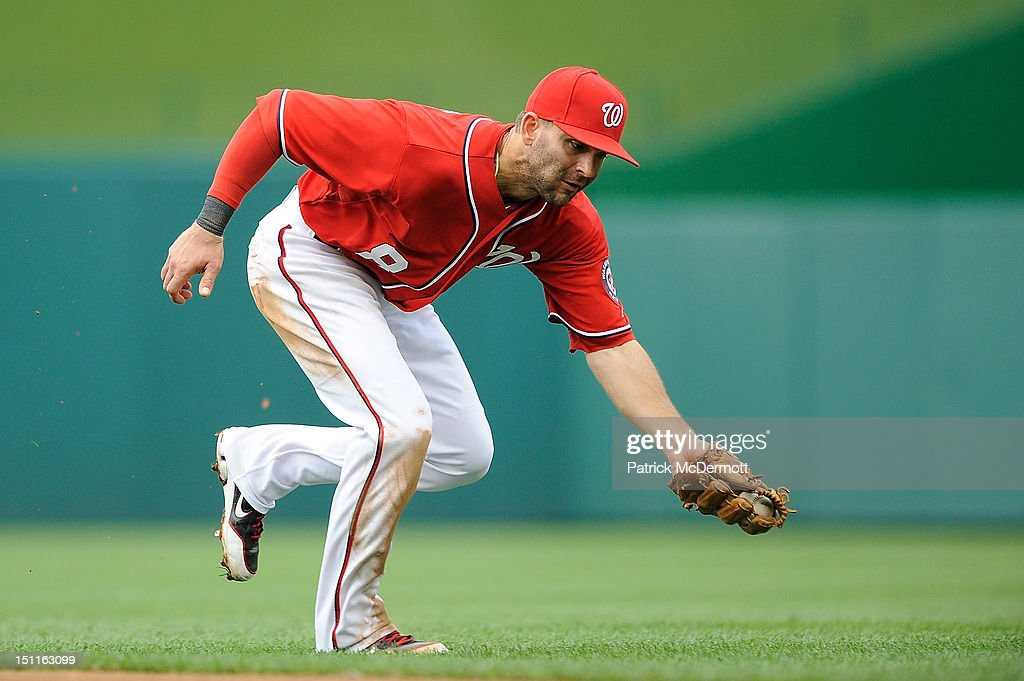 <a gi-track='captionPersonalityLinkClicked' href=/galleries/search?phrase=Danny+Espinosa&family=editorial&specificpeople=4410764 ng-click='$event.stopPropagation()'>Danny Espinosa</a> #8 of the Washington Nationals catches a groundout by Skip Schumaker #55 of the St. Louis Cardinals in the ninth inning during a game at Nationals Park on September 2, 2012 in Washington, DC.