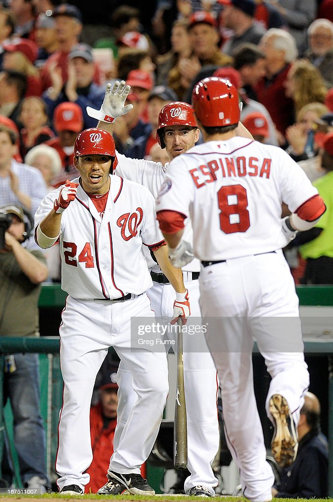<a gi-track='captionPersonalityLinkClicked' href=/galleries/search?phrase=Danny+Espinosa&family=editorial&specificpeople=4410764 ng-click='$event.stopPropagation()'>Danny Espinosa</a> #8 of the Washington Nationals celebrates with <a gi-track='captionPersonalityLinkClicked' href=/galleries/search?phrase=Kurt+Suzuki&family=editorial&specificpeople=682702 ng-click='$event.stopPropagation()'>Kurt Suzuki</a> #24 and <a gi-track='captionPersonalityLinkClicked' href=/galleries/search?phrase=Adam+LaRoche&family=editorial&specificpeople=216533 ng-click='$event.stopPropagation()'>Adam LaRoche</a> #25 after hitting a home run in the third inning against the Cincinnati Reds at Nationals Park on April 25, 2013 in Washington, DC.