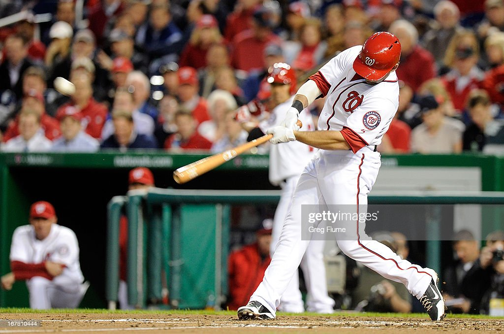 <a gi-track='captionPersonalityLinkClicked' href=/galleries/search?phrase=Danny+Espinosa&family=editorial&specificpeople=4410764 ng-click='$event.stopPropagation()'>Danny Espinosa</a> #8 of the Washington Nationals hits a home run in the third inning against the Cincinnati Reds at Nationals Park on April 25, 2013 in Washington, DC.