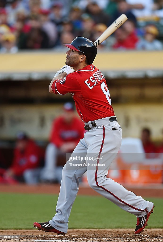 <a gi-track='captionPersonalityLinkClicked' href=/galleries/search?phrase=Danny+Espinosa&family=editorial&specificpeople=4410764 ng-click='$event.stopPropagation()'>Danny Espinosa</a> #8 of the Washington Nationals hits a solo home run in the top of the third inning against the Oakland Athletics at O.co Coliseum on May 10, 2014 in Oakland, California.