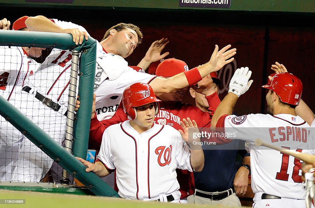 Danny Espinosa #18 of the Washington Nationals is congratulated by Ryan Zimmerman #11 after hitting a home run in the seventh inning against the St. Louis Cardinals at Nationals Park on June 15, 2011 in Washington, DC.
