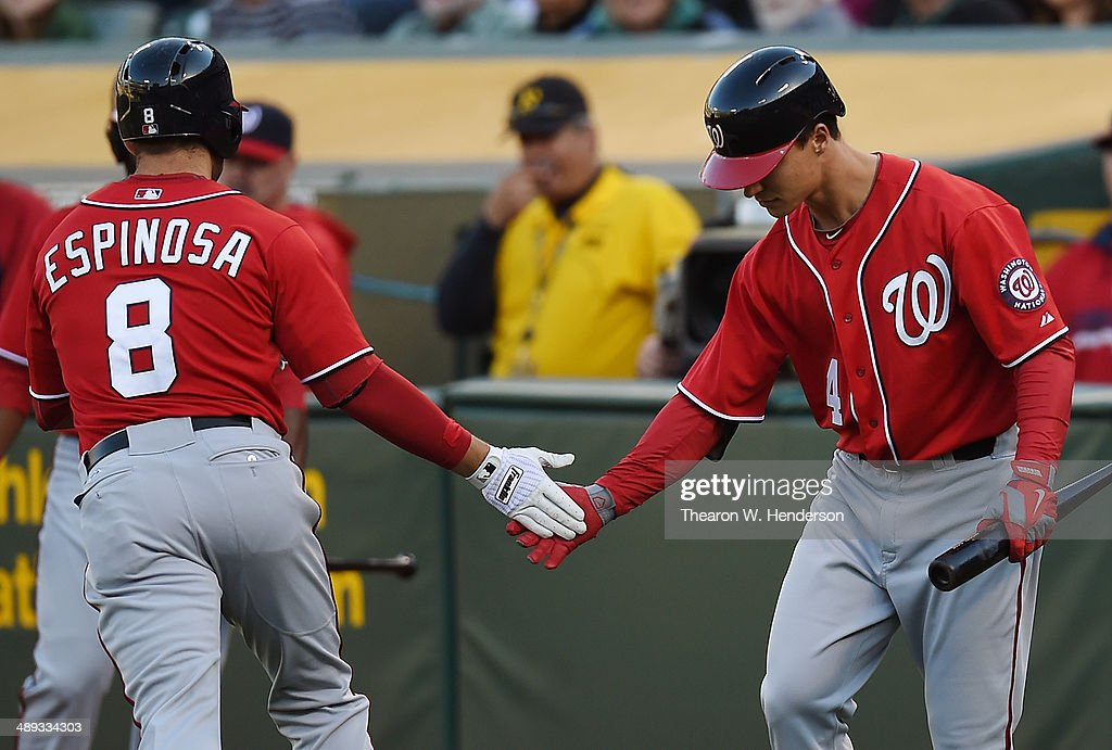 <a gi-track='captionPersonalityLinkClicked' href=/galleries/search?phrase=Danny+Espinosa&family=editorial&specificpeople=4410764 ng-click='$event.stopPropagation()'>Danny Espinosa</a> #8 of the Washington Nationals is congratulated by Zach Walters #4 after Espinosa hit a solo home run in the top of the third inning against the Oakland Athletics at O.co Coliseum on May 10, 2014 in Oakland, California.