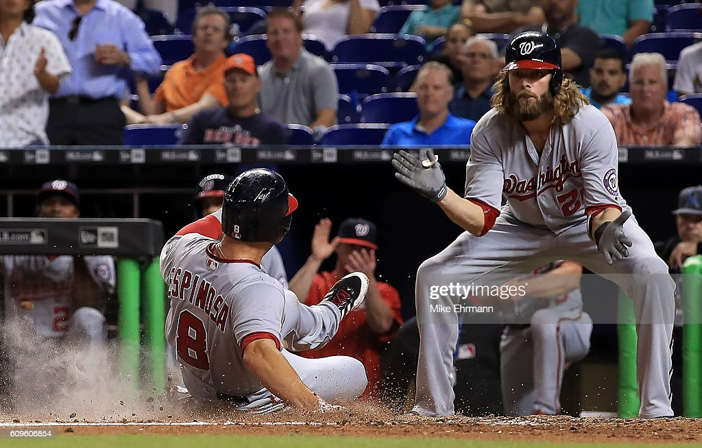 Danny Espinosa #8 of the Washington Nationals is greeted at the plate by Jayson Werth #28 after scoring on an error during a game against the Miami Marlins at Marlins Park on September 21, 2016 in Miami, Florida.