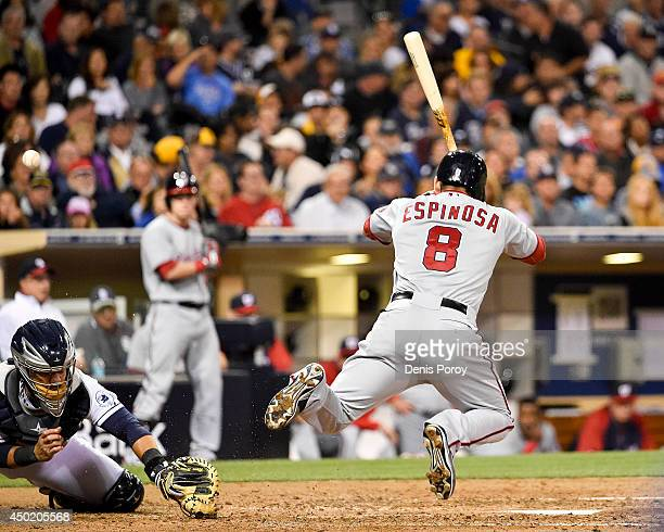 Danny Espinosa of the Washington Nationals is hit with a pitch as Rene Rivera of the San Diego Padres tries to field the ball during the sixth inning...