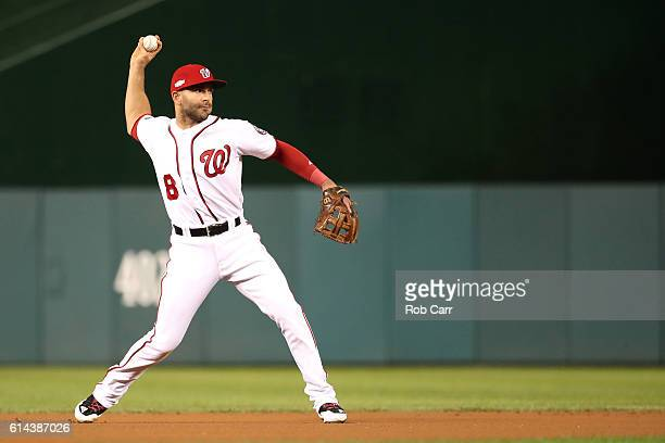 Danny Espinosa of the Washington Nationals makes a throw to first base for third out of the first inning against the Los Angeles Dodgers during game...