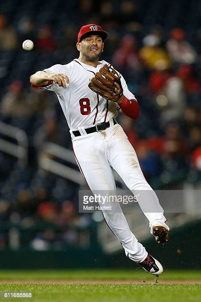 Danny Espinosa of the Washington Nationals misses the throw to first in the sixth inning against the Miami Marlins at Nationals Park on September 30...