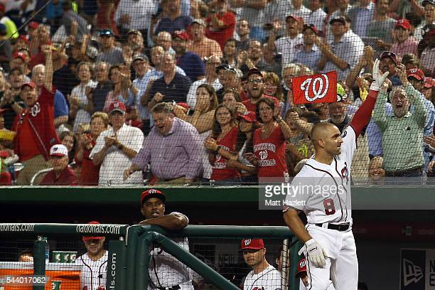 Danny Espinosa of the Washington Nationals receives a curtain call after hitting a threerun home run in the fourth inning against the Cincinnati Reds...