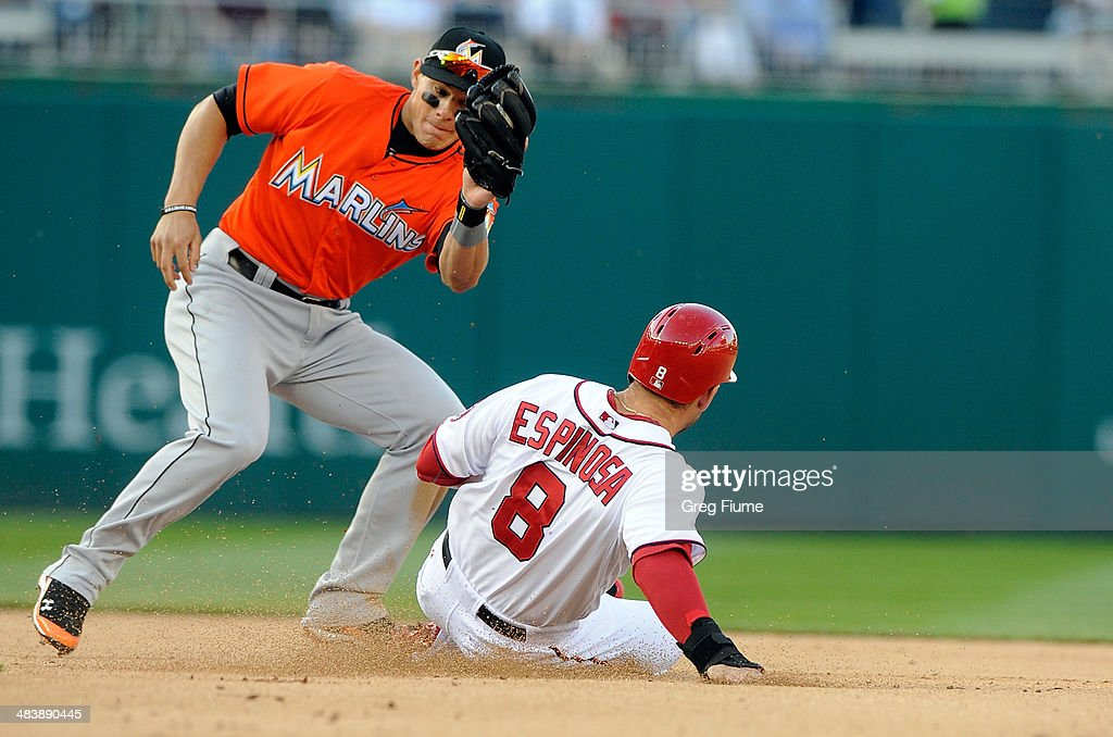Danny Espinosa #8 of the Washington Nationals steals second base in the seventh inning against Derek Dietrich #32 of the Miami Marlins at Nationals Park on April 10, 2014 in Washington, DC.