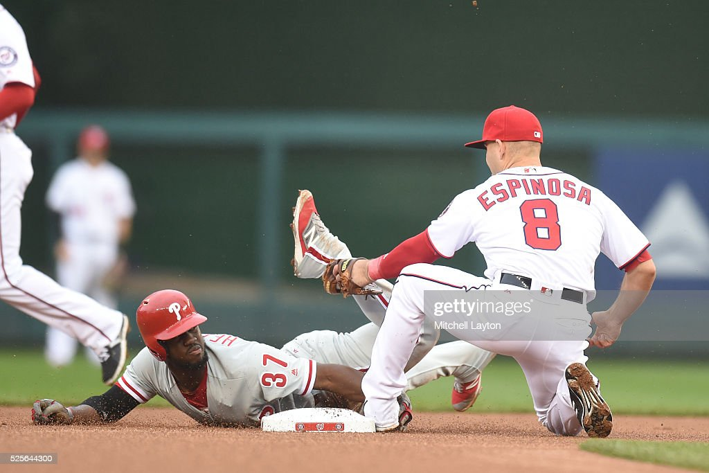Danny Espinosa #8 of the Washington Nationals tags out Odubel Herrera #37 of the Philadelphia Phillies trying to steal second base in the first inning during a baseball game at Nationals Park on April 28, 2016 in Washington, D.C.