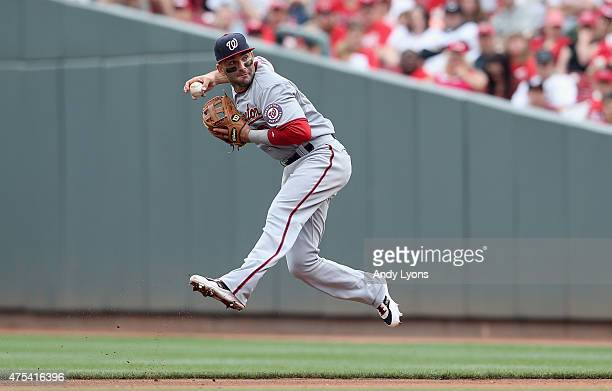 Danny Espinosa of the Washington Nationals throws the ball to first base during the game against the Cincinnati Reds at Great American Ball Park on...