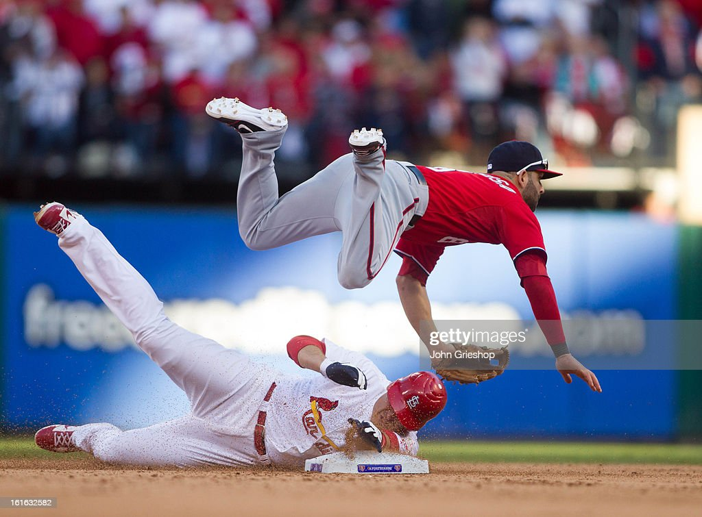 <a gi-track='captionPersonalityLinkClicked' href=/galleries/search?phrase=Danny+Espinosa&family=editorial&specificpeople=4410764 ng-click='$event.stopPropagation()'>Danny Espinosa</a> #8 of the Washington Nationals turns a double play <a gi-track='captionPersonalityLinkClicked' href=/galleries/search?phrase=Allen+Craig&family=editorial&specificpeople=4405049 ng-click='$event.stopPropagation()'>Allen Craig</a> #21 of the St. Louis Cardinals slides into second base during Game 1 of the National League Division Series at Busch Stadium on Sunday, October 7, 2012 in St. Louis, Missouri. The Nationals defeated the Cardinals 3-2.