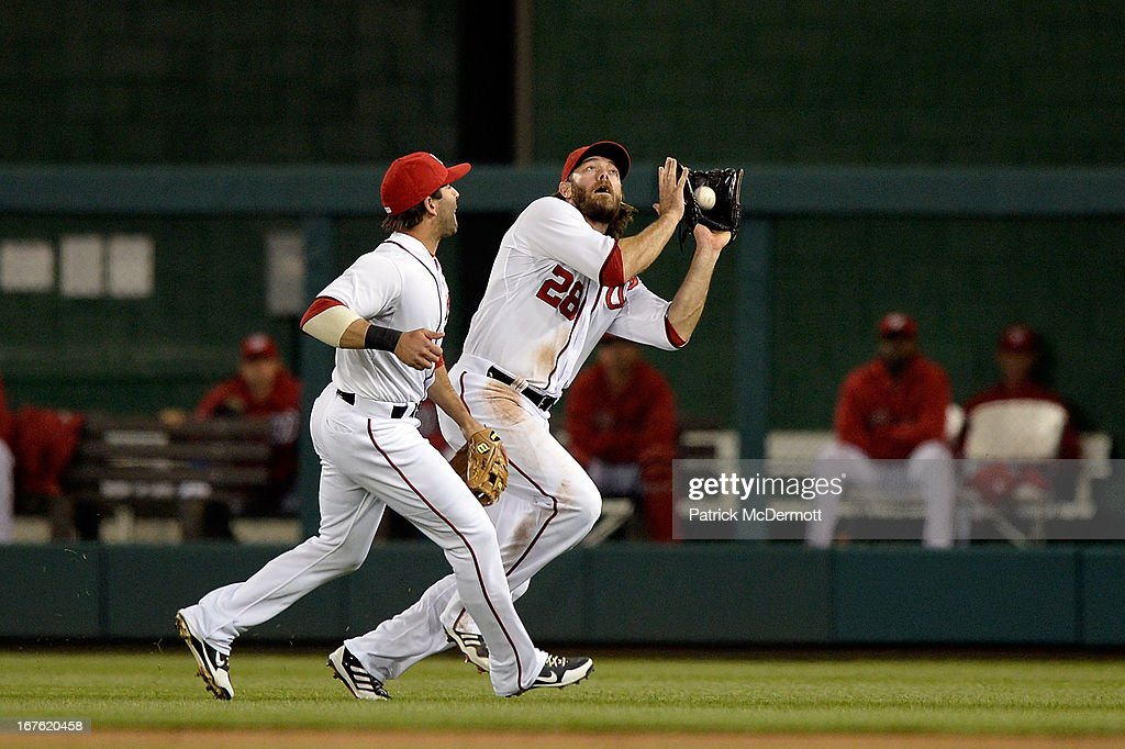 <a gi-track='captionPersonalityLinkClicked' href=/galleries/search?phrase=Danny+Espinosa&family=editorial&specificpeople=4410764 ng-click='$event.stopPropagation()'>Danny Espinosa</a> #8 of the Washington Nationals watches teammate <a gi-track='captionPersonalityLinkClicked' href=/galleries/search?phrase=Jayson+Werth&family=editorial&specificpeople=206490 ng-click='$event.stopPropagation()'>Jayson Werth</a> #28 catch a fly ball hit by Corky Miller #37 of the Cincinnati Reds in the fifth inning of a game at Nationals Park on April 26, 2013 in Washington, DC.
