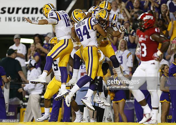 Danny Etling of the LSU Tigers celebrates his touchdown with teammates during the first half of a game against the Jacksonville State Gamecocks at...