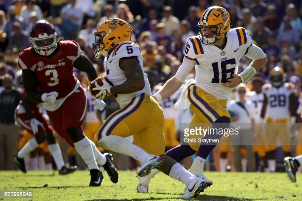 Danny Etling of the LSU Tigers hands the ball to Derrius Guice of the LSU Tigers against the Arkansas Razorbacks at Tiger Stadium on November 11 2017...